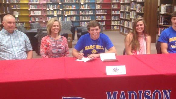 Madison senior Jordan Baker has signed to play college baseball for Mars Hill.