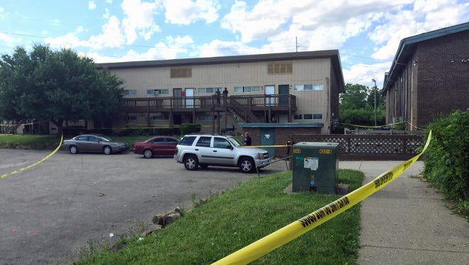 IMPD officers talk at the scene of a shooting on the north east side, at the Shadeland Court apartments at the 3900 block of E. Shadeland Ave. Three people were shot, and taken to Eskenazi Hospital just after 4 p.m. Sunday. All three were stable condition.