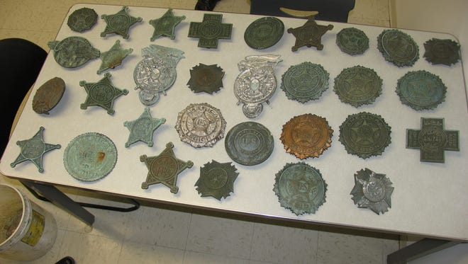 U.S. Military Veteran/American Legion grave markers that police believe were stolen. They were recovered during a burglary investigation.