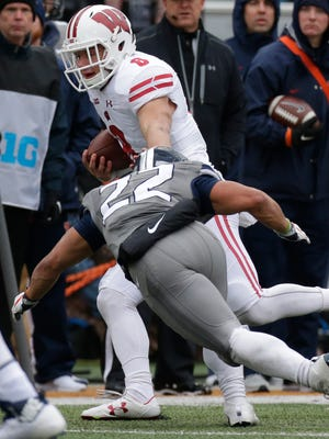 Wisconsin safety Joe Ferguson returns an interception during the fourth quarter.