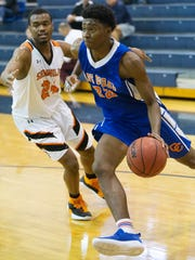 Cape Coral High School's Harwin Francois drives to