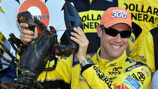 NASCAR Sprint Cup Series driver Matt Kenseth holds up the Louden lobster in victory lane after winning the Sylvania 300 at New Hampshire Motor Speedway.