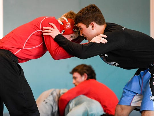 Payne Carr (left) and Saul Ervin grapple during a afternoon