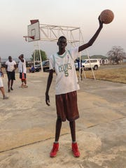 Mabor Majak, then 14, at the outdoor court in South