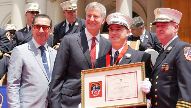 FDNY Lieutenant John D. McGinty of Mahopac received the Uniformed Fire Officers Association Medal