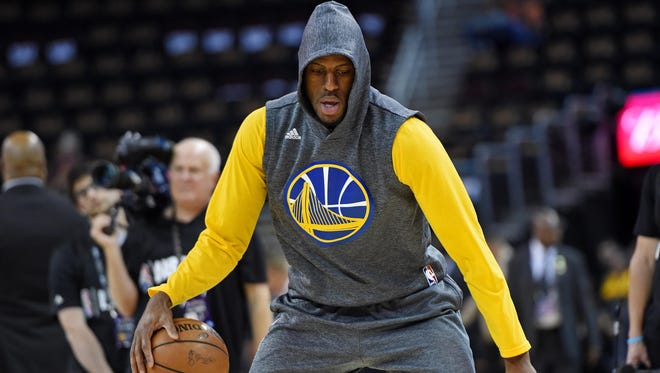 Golden State Warriors forward Andre Iguodala (9) warms up before game six of the NBA Finals against the Cleveland Cavaliers at Quicken Loans Arena.