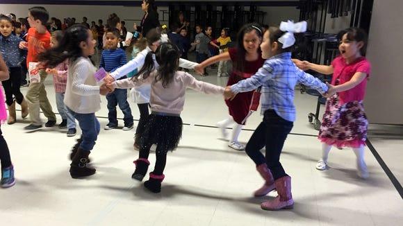 Students enjoy a dance at O'Shea Keleher Elementary School.