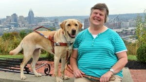 West Price Hill resident Katherine (Kitty) Hevener with her new guide dog.