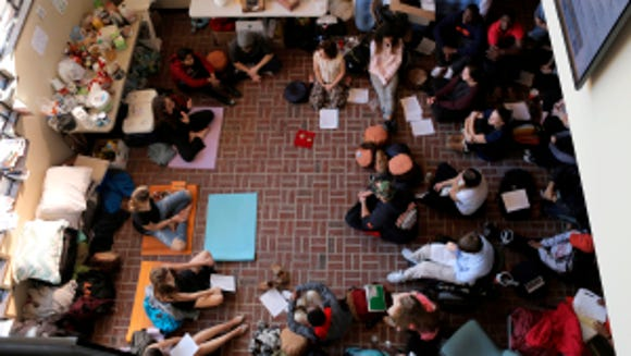 Students participating in the sit in protest. (Photo by Luke Rafferty)