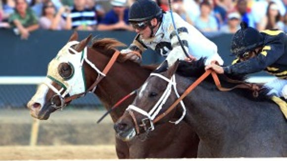 Will Take Charge edged stablemate Oxbow in the 2014 Rebel Stakes, which will be worth $750,000 in 2015. Coady Photography/Oaklawn Park photo