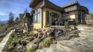 A home in British Columbia that we had the opportunity to do the entire landscape program . . . including a cascading water feature that teminates at a koi fish pond at the bottom.