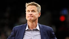 Golden State Warriors head coach Steve Kerr looks on