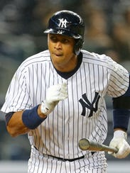 Alex Rodriguez darts from the box after hitting his