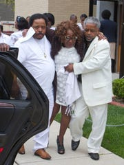 Patricia Basden, the mother of Corey Basden, who was shot and killed April 18, is helped to a limousine after his memorial service in Asbury Park on April 28, 2016.