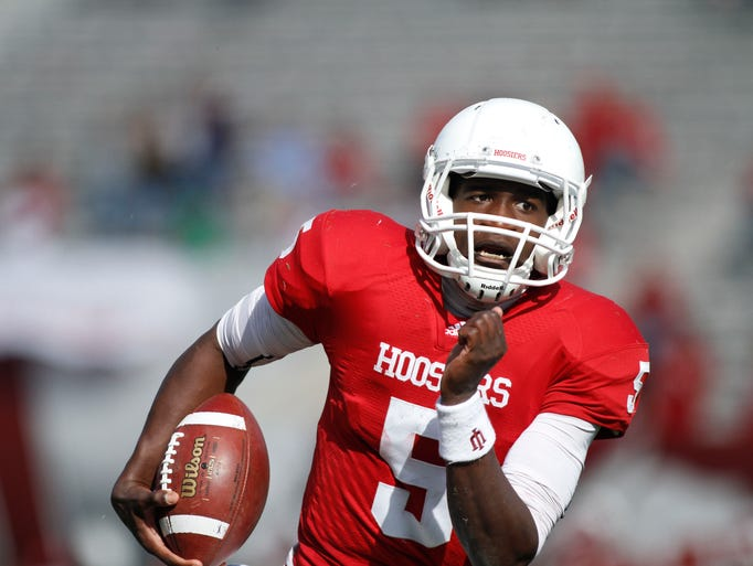 IU quarterback Tre Roberson runs with the ball a college football game at Memorial Stadium in Bloomington, In, Saturday, Oct. 29, 2011. IU lost 59-38.