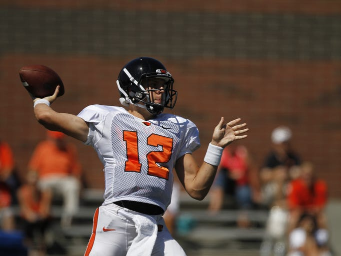 Oregon State University quarterback Luke Del Rio (12) makes a pass during fall camp on Friday, Aug 8, 2014, in Corvallis, Ore.