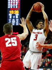 Rutgers Scarlet Knights guard Corey Sanders (3) goes to the basket against Wisconsin Badgers forward Alex Illikainen (25)