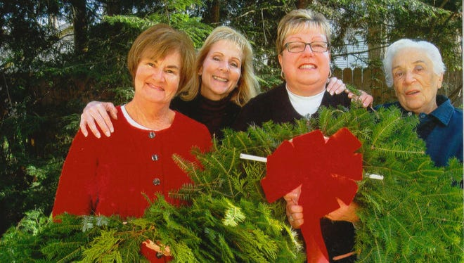 Port Huron Garden Club members, from left, Mary Jo Edson, Shirley Campbell, Pam West and Doris Rutledge pose with examples of the greenery sold at the club's annual greens sale Nov. 4. Proceeds from the sale are used to buy flowers for the seven flower beds planted and maintained by the club.