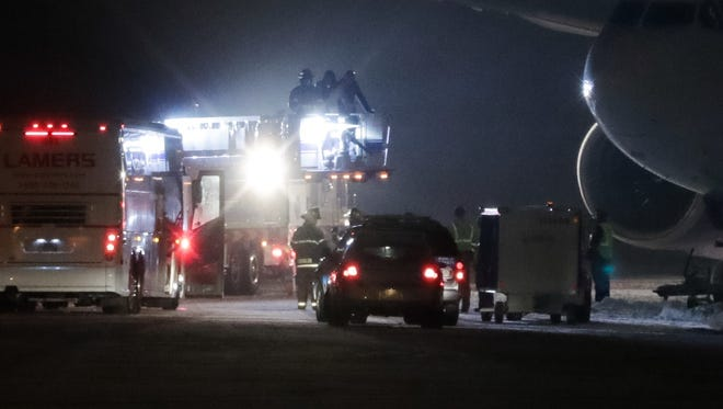 Minnesota Vikings players, coaches and staff and brought off their stranded airplane two and three at a time via a fire truck on Friday night at the Appleton International Airport in Greenville.