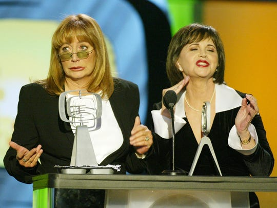 "Penny Marshall and Cindy Williams accept their Working Stiff of the Year award for ""Laverne & Shirley"""