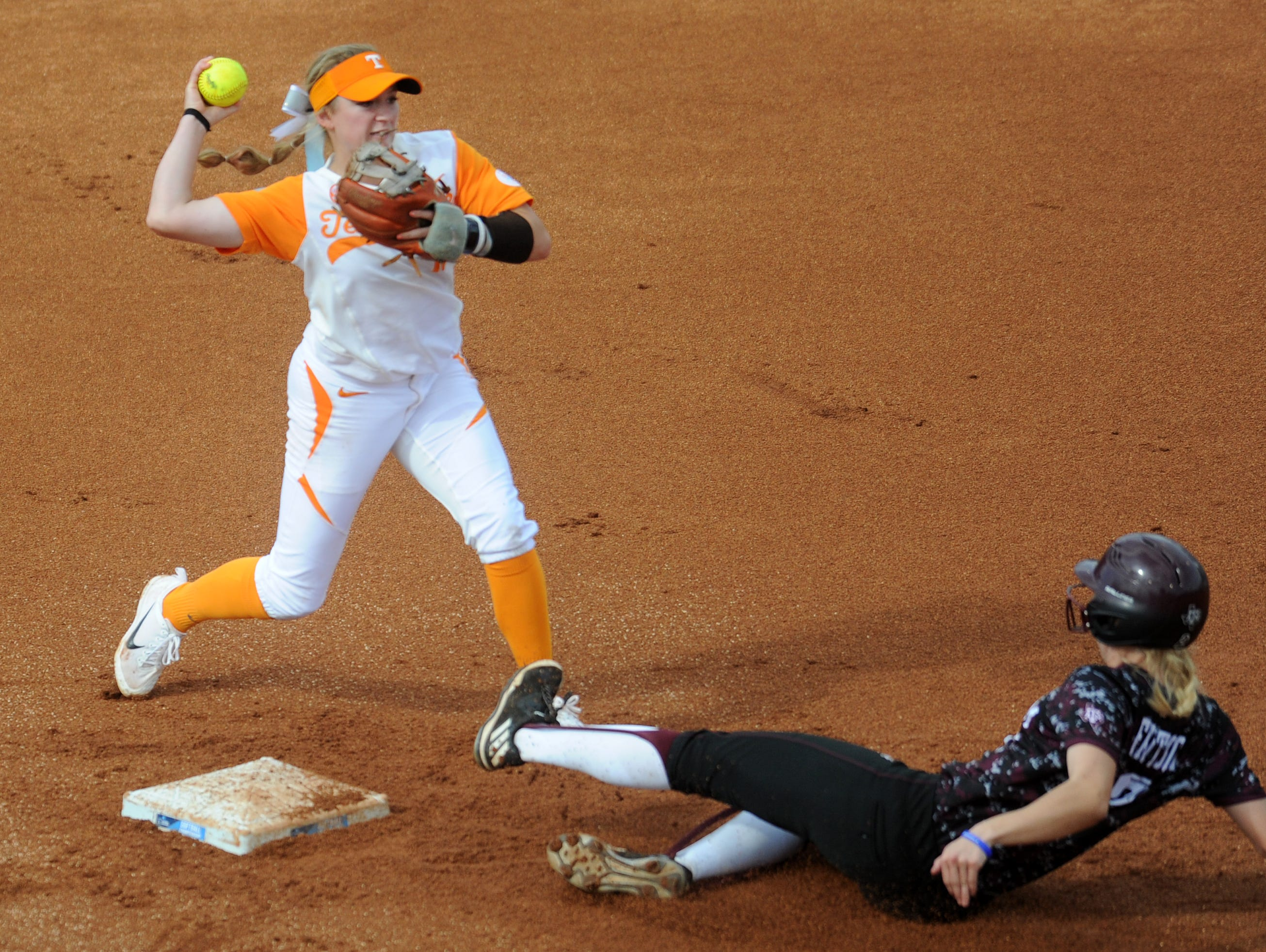 Tennessee's Aubrey Leach (10) makes a throw to first for a successful double play during an NCAA Super Regional game between Tennessee and Texas A&M at Sherri Parker Lee Stadium on Sunday, May 28, 2017. Texas A&M defeated Tennessee 5-3, and will head to Oklahoma City for the NCAA Women's College World Series.