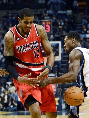 Memphis Grizzlies guard Tony Allen (9) steals the ball away from Portland Trail Blazers forward LaMarcus Aldridge (12) in the first half of an NBA basketball game Saturday, March 21, 2015, in Memphis, Tenn.