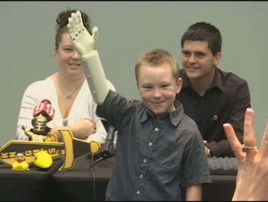 Six-year-old Alex Pring received his new robotic arm and hand at the Fairwinds Alumni Center Tuesday morning.