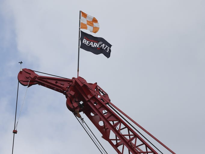 A Cincinnati Bearcats flag flies on the top of a crane as construction continues on the reworking and expansion of Nippert Stadium on the University of Cincinnati's campus.