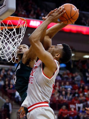 Michigan State's Marvin Clark Jr., left, fouls Ohio State's Trevor Thompson during the second half.