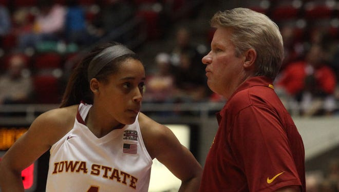 Nikki Moody talks with Iowa State head women's basketball coach Bill Fennelly during a game against Wayne Statte College in November 2013.