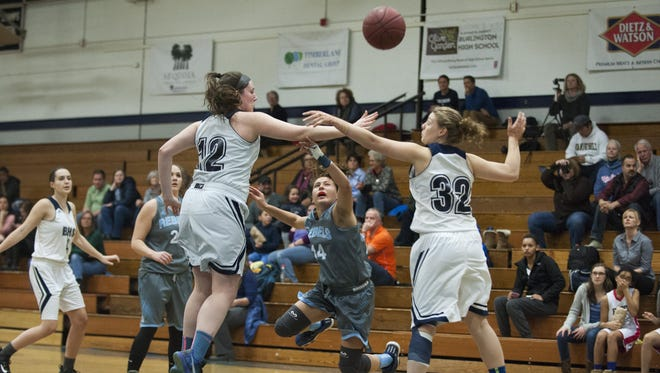South Burlington's Liz Sargent (14) gets tripped up while trying to drive to the hoop past Burlington's Makayla King (12) and Devin Libby (23) during the girls basketball game between the South Burlington Rebels and the Burlington Seahorses at Burlington High School on Tuesday night Febraury 2, 2016 in Burlington.