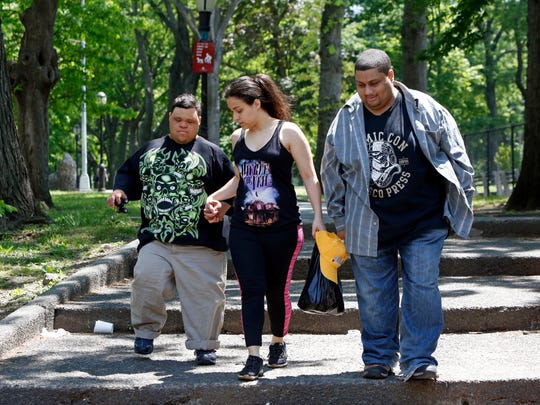 Bianca Jeannot, 22, walks with her brothers Michael