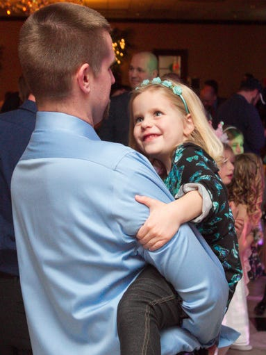 Jason Weber and his 6-year-old daughter Kinley Weber