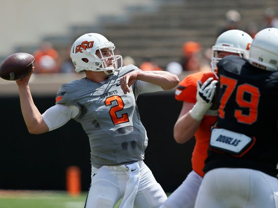Oklahoma State quarterback Mason Rudolph (2) passes during an intra squad spring NCAA college football game in Stillwater, Okla. Oklahoma State has never won a Big 12 title or played in the championship game, but goes into coach Mike Gundy's 13th season with quarterback Rudolph, receiver James Washington and running back Justice Hill.