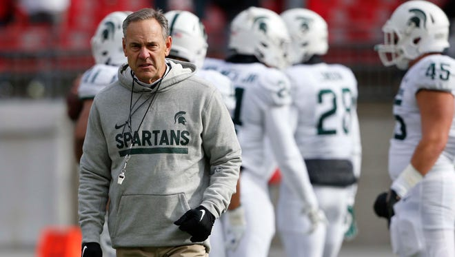 Nov 11, 2017; Columbus, OH, USA; Michigan State Spartans head coach Mark Dantonio enters the field before the game against the Ohio State Buckeyes at Ohio Stadium.