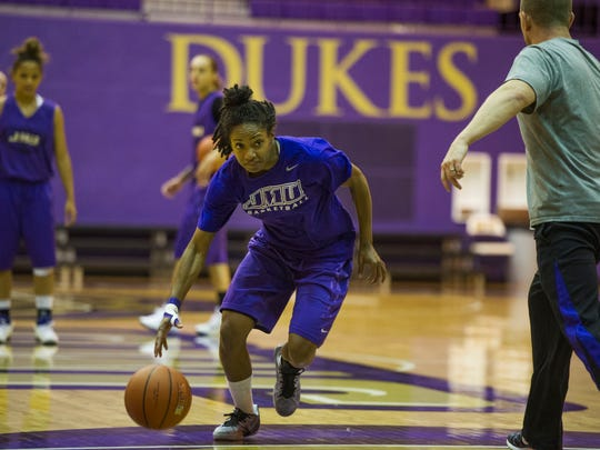 Angela Mickens, a point guard for James Madison University's women's basketball team, drives toward the hoop during practice in Harrisonburg on Wednesday.