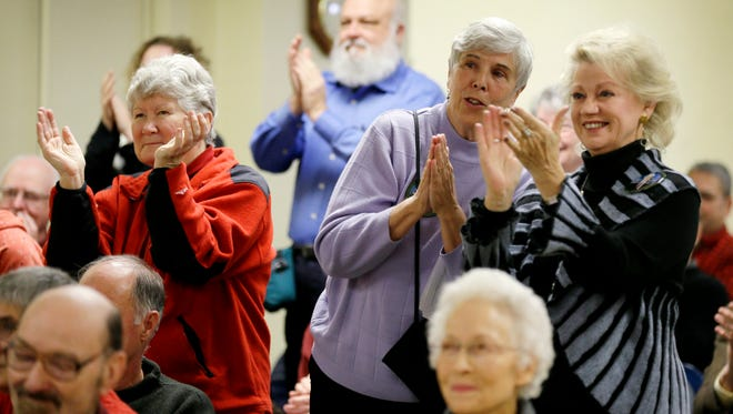 Local residents react as they listen to Sen. Bernie Sanders, I-Vt. speak during a town hall meeting, Tuesday, Dec. 16, 2014, in Ames, Iowa. Sanders, as both a liberal and independent, is in two groups that showed low death rates in a new study. If his supporters share those traits -- and some yet-to-be-determined healthy traits that accompany those political leanings -- they might live longer, too.