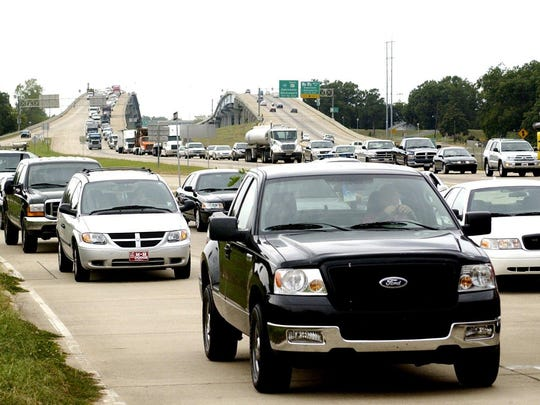 Northbound traffic on the Cottingham Expressway and service road in Pineville is tied up by a traffic accident in this 2009 photo. Improved roads and bridges will lead to less time lost to traffic for motorists, transportation stakeholders argue.