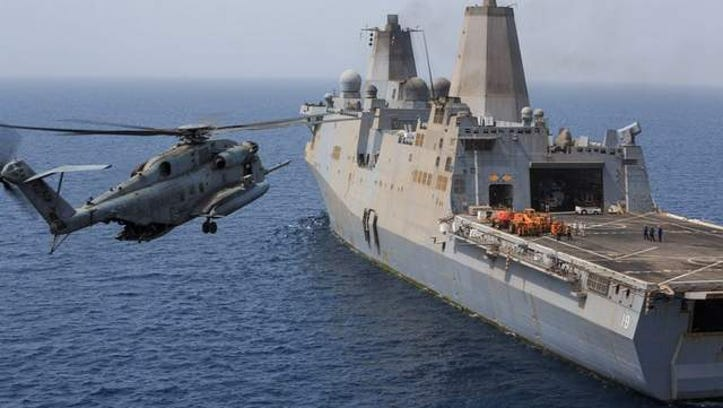 A Marine Corps CH-53E Super Stallion prepares to land aboard the amphibious transport dock ship USS the Mesa Verde (LPD 19) on Aug. 4, 2014. A CH-53 crashed Sept. 1 in the Gulf of Aden as it attempted to land on the USS Mesa Verde. Officials report that there were no fatalities in the crash and all personnel were recovered.