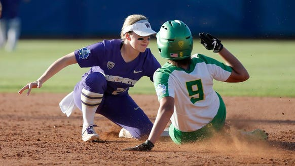 Washington's Sis Bates (22) tags out Oregon's Shannon