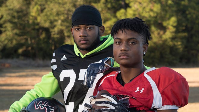 West Floria High School's Helton twins, Keyon, left, and Keyshawn, are critical leaders in the Jaguars record-breaking 2017 football season. The two seniors and the rest of the West Florida gridiron gang will be playing Baker County this Friday.