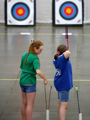 Elementary students are seen participating in the U.S. National Archery Tournament at the Kentucky Fair and Exposition Center.