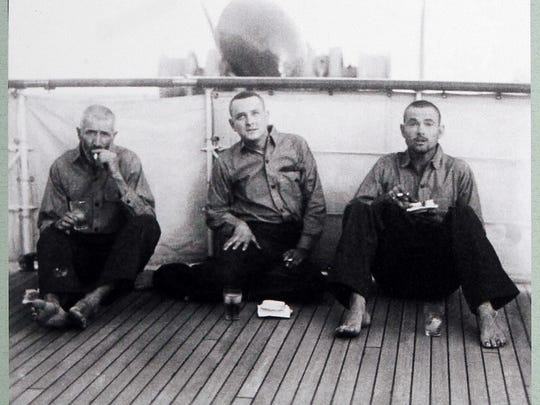 Copy of a photo of three men discovered marooned on Cocos Island by Julius and Dorette Fleischmann during an around the world trip aboard their  225-foot-long yacht, Camargo, 1931-32. Artifacts they collected are part of the Cincinnati Museum Center's Treasures of Travel: Cincinnatians Collect the World.