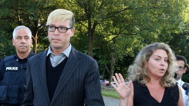 Christopher Schraufnagel leaves New Castle Town court with his attorney, Stacey Richman, after his court appearance Thursday.