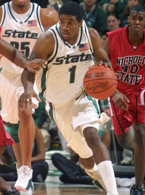 Michigan State's Marcus Taylor (1) leads a fast break trailed by Nicholls State's Dominique Gleason (40) and Michigan State's Aloysius Anagonye, left, in the second half on Dec. 9, 2001, in East Lansing.