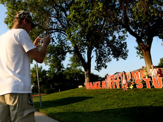 Jon Saterstad takes a picture of his kids Summer, 7, center, and Savanah, 8, Wednesday at Manzanita Elementary School.