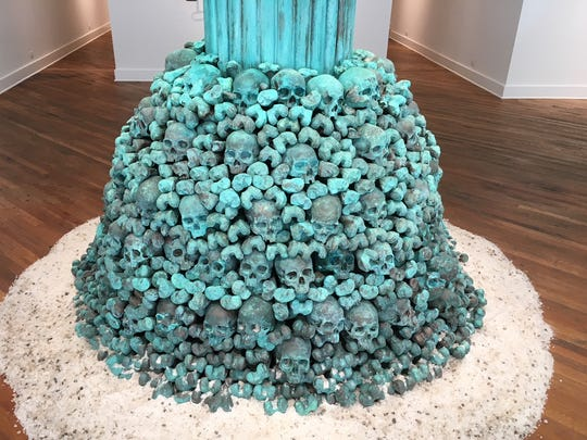 """Painted skulls and bones, made of gypsum, comprise the base of Scott Hocking's """"OLD"""" at Detroit's David Klein Gallery."""
