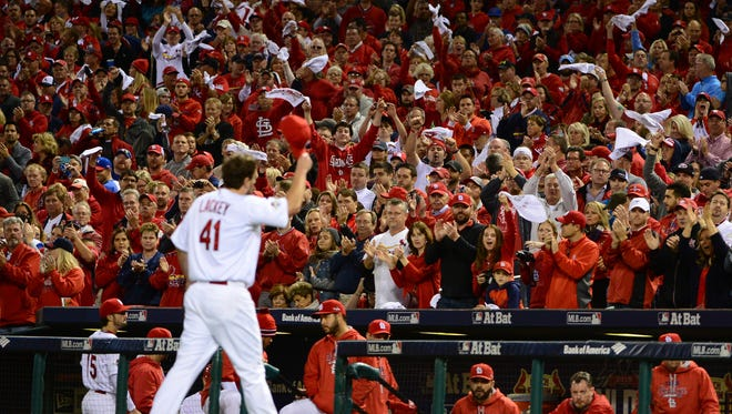 """Playoffs, man, that's what you play for,"" said Cardinals starter John Lackey, who took a shutout into the eighth inning of Game 1 of the NL Division Series."