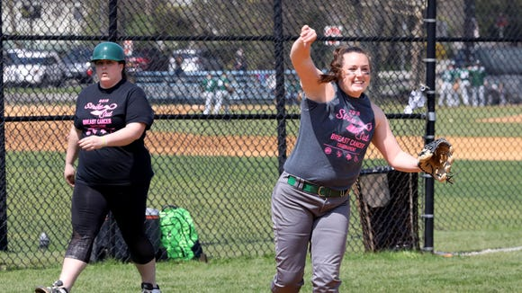 Kate Degnan, left, the Hastings High School softball coach and her sister Kelly Degnan, a senior at Irvington High School are pictured during their game at the Rivertowns Strike Out Breast Cancer tournament in Ardsley, April 28, 2018.
