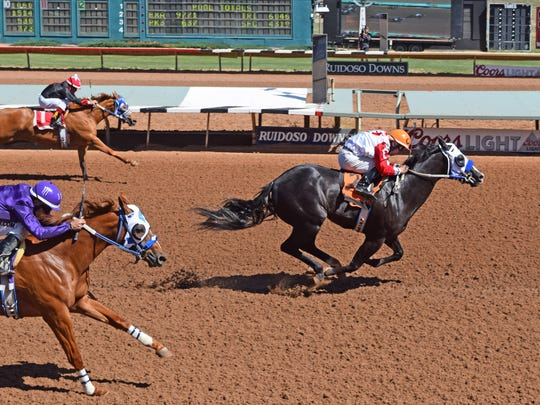 A Revenant races to a win in the ninth of 15 trials for the Ruidoso Futurity on Friday in Ruidoso Downs, N.M. He won in a time of 17.748 with jockey Cody Jensen aboard.